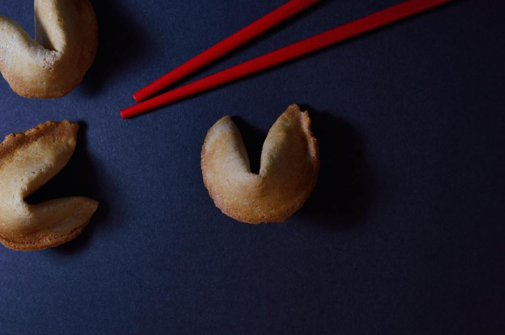 red chopsticks with baked fortune cookies
